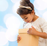 Happy child girl with gift box Royalty Free Stock Images