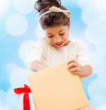Happy child girl with gift box Stock Photo