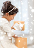 Happy child girl with gift box Royalty Free Stock Photography