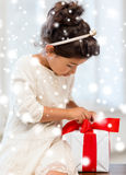 Happy child girl with gift box Royalty Free Stock Photos