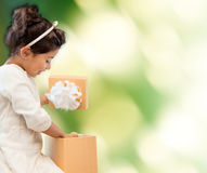 Happy child girl with gift box Royalty Free Stock Image