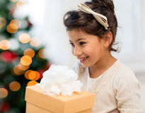 Happy child girl with gift box Stock Images