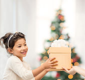 Happy child girl with gift box Stock Photo