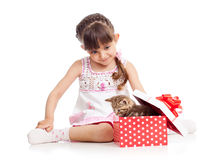 Happy child girl with gift box with kitten Stock Photo