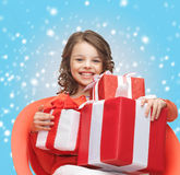Happy child girl with gift boxes Royalty Free Stock Images