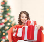 Happy child girl with gift boxes Royalty Free Stock Photography