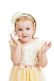 Happy child girl with hands close to the face Stock Photo