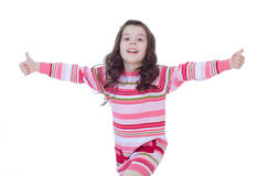 Happy child girl with hands thumbs up Royalty Free Stock Photos