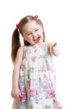 Happy child girl with hands thumbs up. Happy child girl shows hands thumbs up royalty free stock photos