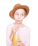 Happy child girl in a hat with a bottle of fruit juice drink Stock Images