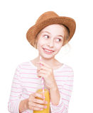 Happy child girl in a hat with a bottle of fruit juice drink Royalty Free Stock Photo