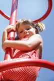 Happy child girl having fun on playground Stock Photo