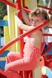 Happy child girl having fun on playground Stock Image