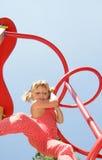 Happy child girl having fun on playground Royalty Free Stock Image