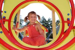 Happy child girl having fun on playground Stock Images