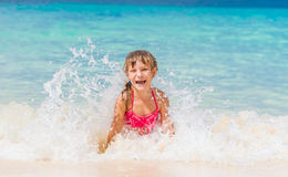 Happy child girl having fun in water, tropical summer vaca Royalty Free Stock Images