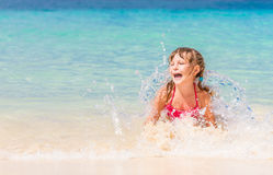 Happy child girl having fun in water, tropical summer vaca Stock Photography