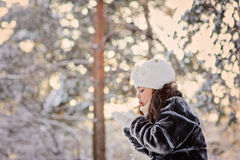 Happy child girl having fun in winter snowy forest Royalty Free Stock Photography