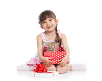 Happy child girl holding gift box with kitten Royalty Free Stock Images