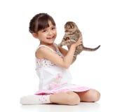 Happy child girl holding kitten stock image