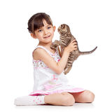 Happy child girl holding kitten isolated Stock Photos