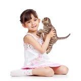 Happy child girl holding kitten isolated Stock Photos