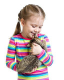 Happy child girl holding kitten isolated on white Stock Images