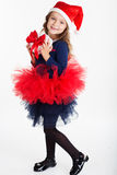 Happy child girl is holding red gift box Stock Photos