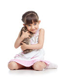 Happy child girl hugging kitten isolated Royalty Free Stock Photo