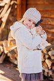 Happy child girl hugs her teddy bear Stock Photo