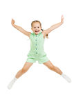 Happy child girl jumping isolated on white Royalty Free Stock Photos