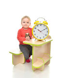 Happy child girl kid standing near little table with big yellow Royalty Free Stock Photo