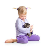Happy child girl with kitten Royalty Free Stock Photography