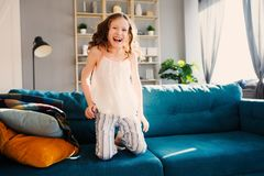Happy child girl playing at home in cozy weekend morning Stock Photos