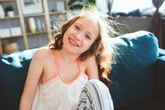 Happy child girl playing at home in cozy weekend morning royalty free stock photo