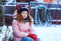 happy child girl playing outdoor in snowy winter garden. royalty free stock photo