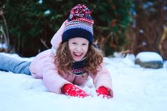 happy child girl playing outdoor in snowy winter garden royalty free stock photography