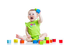 Happy child girl playing toys isolated Stock Photo