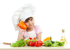 Happy child girl preparing vegetarian dish Royalty Free Stock Image