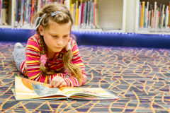 happy child girl reading a book Royalty Free Stock Images