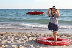 Happy child girl ready for travel by boat Royalty Free Stock Photo