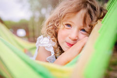 Happy child girl relaxing in hammock in summer Stock Photography