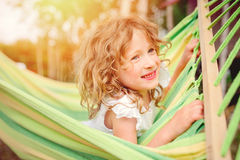 Happy child girl relaxing in hammock in summer Royalty Free Stock Image