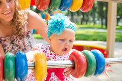 Happy child girl riding train on funfair on summer vacation.  Royalty Free Stock Images