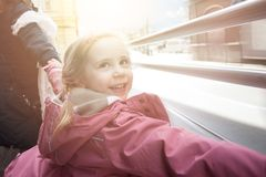 Happy child girl running and having fun outdoors, childhood and people traveling concept stock photography