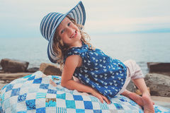 Happy child girl at sea, cozy summer holidays on seaside Stock Photos