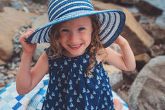 Happy child girl at sea, cozy summer holidays on seaside Stock Image
