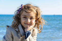 Happy child girl at sea portrait Stock Photo