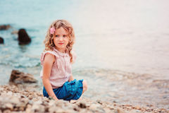 Happy child girl on seaside on summer vacation Royalty Free Stock Image