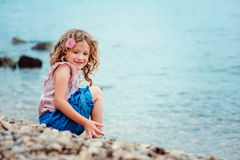 Happy child girl on seaside on summer vacation Royalty Free Stock Photography